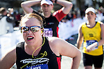 © Licensed to London News Pictures . 10/04/2016 . Manchester , UK . Race runners at the finishing line of the 40th Greater Manchester Marathon . Photo credit : Joel Goodman/LNP