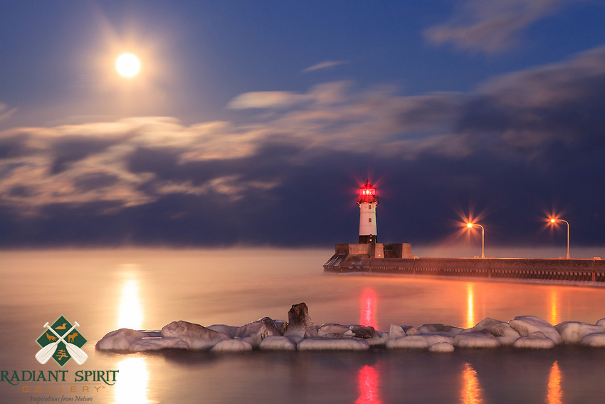 """""""Full Moon and Sea Smoke""""<br /> As the full moon rose over Lake Superior on a subzero evening, it illuminated the sea smoke and clouds, painting a dramatic scene. Watching the moon rise as it backlit the sea smoke and morphing clouds was mesmerizing and awe-inspiring."""