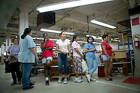 21 June 2005 - Oaks, PA - Workers wait to clock out at the Annin & Co. American flag manufacturing plant in Oaks, PA.