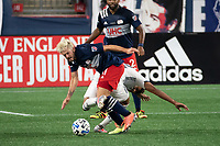 FOXBOROUGH, UNITED STATES - AUGUST 20: Kelyn Rowe #11 of New England Revolution and Matt Real #32 of Philadelphia Union collide in the midfield during a game between Philadelphia Union and New England Revolution at Gilette on August 20, 2020 in Foxborough, Massachusetts.