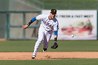 Surprise Saguaros third baseman Charles Leblanc (12), of the Texas Rangers organization, fields a ground ball during an Arizona Fall League game against the Peoria Javelinas at Surprise Stadium on October 17, 2018 in Surprise, Arizona. (Zachary Lucy/Four Seam Images)
