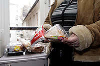 A young Chechen woman, display out of date prepare food (sandwichs, chicken, Mozzarella cheese and toast bread), collect in a trash bin at the back of a supermarket in Paris. She feed here ill husband and here 2 young boy with. The French government do not help the refugees with food. 90% of the refugee depend on the Soupe populaire evening soup give by the city administration or by humanitarian association..In 2002, during a funeral, the husband was arrested for possessing a gun on him. 3000.-$ was the cost for liberate him of 8 days and night of torture. 8 month later, army men with hid face break the door and everything in the apartment, beat the wife and the 2 young boys and kidnap the husband. 6 days of torture later, the solders contact the Imam of the neighbourhood, asking 6000.-$ for release the husband. The wife collect the money trough the family and friends and pay the ransom..The 1 November 2004 after several more aggression, they escape to neighbouring Dagestan, where they pay 6500.-$ to human traffickers, for be smuggle to Brest in Byelorussia on the border to Poland. Passing into Poland, they have to registered (finger print) in the centre of Debak, before to be smuggle again to Paris the 16 November..During this journey from Chechnya to Poland, the pregnant wife lost her baby..They live in the East suburb of Paris, in a hotel provide by the CAFDA organisation..Having fail the first request of asylum, they are waiting the second request by the CRR French administration..Ill, with no money left, they live in a permanent fear to be expel back to Russia.