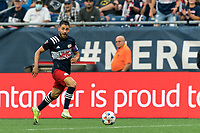 FOXBOROUGH, MA - JULY 25: Carles Gil #22 of New England Revolution looks to pass during a game between CF Montreal and New England Revolution at Gillette Stadium on July 25, 2021 in Foxborough, Massachusetts.