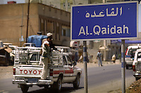 Sign on the road leading into Al-Qaidah, a town in central Yemen. The town has no connection with the Al Qaeda terrorist organisation; the words mean 'the base' or 'the foundation' in Arabic. Local people applying for passports often claim to be from elsewhere as having documents with the name Al-Qaidah on them can present them with travel problems in many parts of the world.