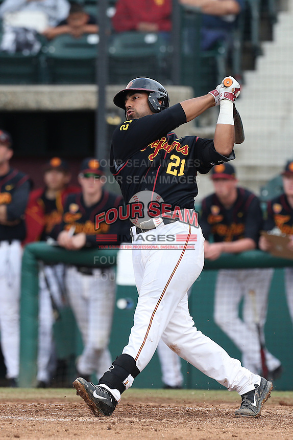 Jake Hernandez #21 of the USC Trojans bats against the Cal Poly Mustangs at Dedeaux Field on March 2, 2014 in Los Angeles, California. Cal Poly defeated USC, 5-1. (Larry Goren/Four Seam Images)