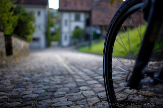 The front wheel of a Flyer e-bike is seen on the cobblestone streets of Burgdof, Emmantal, Switzerland on Aug. 9, 2011.