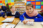 Lisselton NS students Saoirse Fogerty and Aimee Kissane writing heir letters and postcards to the Ballydonoghue residents on Tuesday.