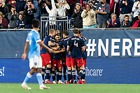 FOXBOROUGH, MA - SEPTEMBER 11: Carles Gil #22 of New England Revolution celebrates his assist with teammates during a game between New York City FC and New England Revolution at Gillette Stadium on September 11, 2021 in Foxborough, Massachusetts.