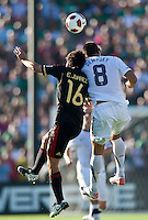 PASADENA, CA – June 25, 2011: Mexico player Efrain Juarez (16) and USA player Clint Dempsey (8) during the Gold Cup Final match between USA and Mexico at the Rose Bowl in Pasadena, California. Final score USA 2 and Mexico 4.