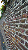 London, England. View along a brick wall.