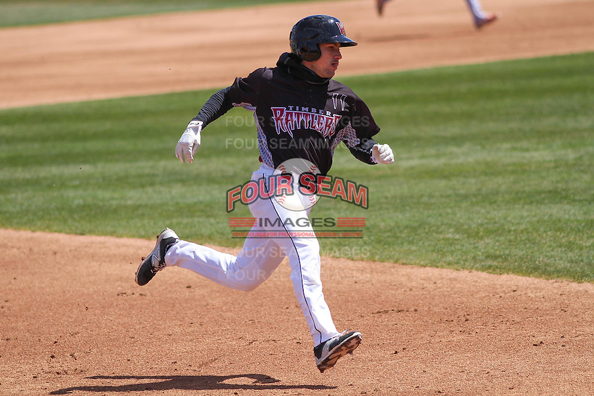 Wisconsin Timber Rattlers catcher Carlos Leal (11) rounds the bases during a game against the Peoria Chiefs on April 25th, 2015 at Fox Cities Stadium in Appleton, Wisconsin.  Wisconsin defeated Peoria 2-0.  (Brad Krause/Four Seam Images)