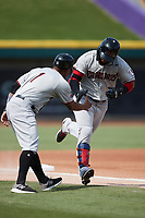 Miguel Aparicio (8) of the Hickory Crawdads shakes hands with third base coach Josh Johnson (1) after hitting a home run during the game against the Winston-Salem Dash at Truist Stadium on July 10, 2021 in Winston-Salem, North Carolina. (Brian Westerholt/Four Seam Images)