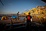 The crew of the Yasoor fishing boat prepare to leave the Jaffa Port , Saturday, June 15 2013. Over fishing pollution and man interfering with nature are the main reasons for depleting marine life in the Israeli Mediterranean Sea. Photo by Eyal Warshavsky