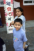 Bangladeshi children outside their Spitalfields estate flat decorated for a forthcoming family wedding.