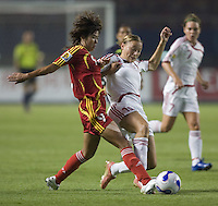 Denmark defender (15) Mariann Gajhede tries to tackle the ball away from China forward (9) Han Duan during their first round game at the 2007 FIFA Women's World Cup at Wuhan Sports Center Stadium in Wuhan, China.  China defeated Denmark, 3-2.