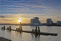 The sun is setting by St David's Hotel in Cardiff Bay, Wales, UK. Tuesday 15 December 2020