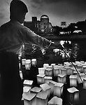 "Colorful paper lanterns that are symbolic of the victims"" souls are set adrift on one of Hiroshima's seven rivers during the anniversary of the bombing.  In the background, the A-bomb Dome is visible, the only original building still standing at the hypocenter. .Pulitzer finalist entry 1989 Frederic Larson©"