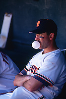 SAN FRANCISCO, CA - Will Clark of the San Francisco Giants sits in the dugout and blows a bubble during a game at Candlestick Park in San Francisco, California in 1992. Photo by Brad Mangin