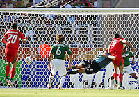 Mexico goalkeeper Oswaldo Sanchez crashes into Rahman Rezaei of Iran as Yahya Golmohammadi's (not pictured) shot goes in for Iran's lone goal. Mexico defeated Iran 3-1 during a World Cup Group D match at Franken-Stadion, Nuremberg, Germany on Sunday June 11, 2006.