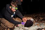 Mountain Lion (Puma concolor) biologist, Chris Fust, handling sub-adult male during collaring, Santa Cruz Puma Project, Santa Cruz, Monterey Bay, California
