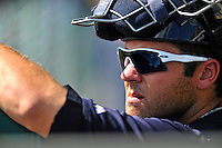 8 March 2011: New York Yankees' catcher Austin Romine watches play from the dugout during a Spring Training game against the Atlanta Braves at Champion Park in Orlando, Florida. The Yankees edged out the Braves 5-4 in Grapefruit League action. Mandatory Credit: Ed Wolfstein Photo