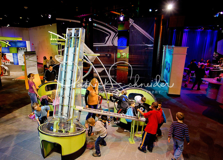 """Charlotte, NC on-location photography of Discovery Place, Charlotte's hands-on science museum located in downtown Charlotte NC. This image was taken in the museum's """"Cool Stuff"""" area, where visitors can launch objects into the air, lie on a bed of nails and uncover the wonders of science with hands-on exploration of multi-dimensional exhibits."""