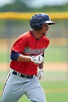 GCL Twins center fielder Jean Carlos Arias (13) runs to first base during the first game of a doubleheader against the GCL Rays on July 18, 2017 at Charlotte Sports Park in Port Charlotte, Florida.  GCL Twins defeated the GCL Rays 11-5 in a continuation of a game that was suspended on July 17th at CenturyLink Sports Complex in Fort Myers, Florida due to inclement weather.  (Mike Janes/Four Seam Images)