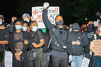"""Thousands gathered in Boston Common in Boston, Massachusetts, on Sun., May 31, 2020, to demonstrate against police brutality after the killing by police of George Floyd in Minneapolis, Minnesota, the previous week. Protests, sometimes violent, have erupted around the United States. This protest was organized by an organization called Black Boston. Protesters often chanted """"Black Lives Matter"""" and """"Fuck the police."""" The protest began at 6:30pm in various parts of the city, and around 9pm, after most protesters had left, there began to be clashes between people and police, especially in the Downtown Crossing area of Boston and around Boston Common.  The protest sign here reads """"No Justice / No Peace."""""""