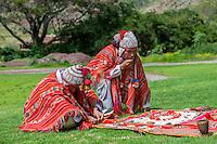 Peru, Urubamba Valley.  Quechua Priest and Apprentice Performing Welcoming Ceremony with Coca Leaves, Hacienda Urubamba.