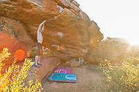 Ned Feehally brushes of holds on 'Sky' 8B in Rocklands, South Africa