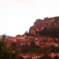 Here, a view of a part of the small town of Tagliacozzo, in the province of L'Aquila, near the boundary between Lazio and Abruzzo, at the sunset light. The old buildings are literally clinged to the hillside, with the characteristic high rocks that stands above them. The image was taken before the recent strong earthquakes. This is an enlargement of the original photo.
