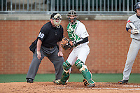 Charlotte 49ers catcher Nick Daddio (20) checks the runner at first base during the game against the Florida Atlantic Owls at Hayes Stadium on March 14, 2015 in Charlotte, North Carolina.  The Owls defeated the 49ers 8-3 in game one of a double header.  (Brian Westerholt/Four Seam Images)