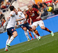 Calcio, Serie A: Roma-Genoa. Roma, stadio Olimpico, 12 gennaio 2014.<br /> AS Roma midfielder Radja Nainggolan, of Belgium, right, is challenged by Genoa midfielder Andrea Bertolacci, center, and midfielder Emanuele Calaio', during the Italian Serie A football match between AS Roma and Genoa, at Rome's Olympic stadium, 12 January 2014. AS Roma won 4-0.<br /> UPDATE IMAGES PRESS/Isabella Bonotto