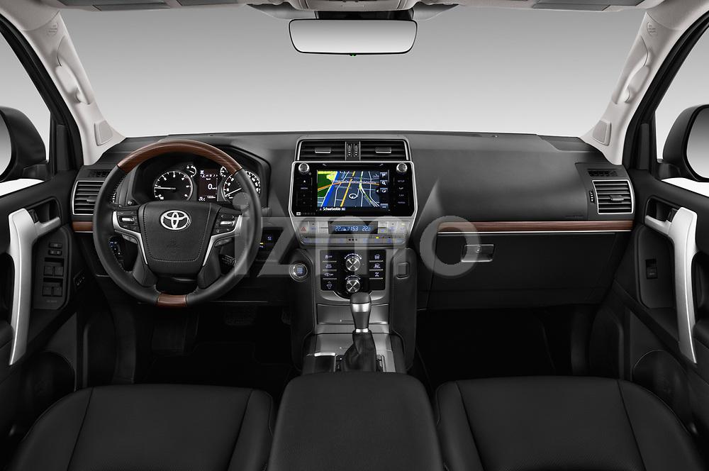 Stock photo of straight dashboard view of a 2018 Toyota Landcruiser Premium 5 Door SUV