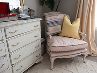 A chair, around thirty years old, was restored by Bartus Taylor for a guest room in his Fayetteville apartment.(NWA Democrat-Gazette/J.T. Wampler)