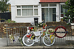 Cyclist died Memento Mori white painted and decorated with flowers symbolic, symbolising the death of a cyclist in a road traffic accident. Croydon London. UK 2012