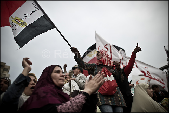 "© Remi OCHLIK/IP3 - Cairo Feb. 01 -- Tahrir square - Women yell  ""Mubarak get out!"" during the Egypt's ""million man march"".Whether they achieved that targeted head count is unclear, but their message was unequivocal.""Mubarak get out!"" protesters chanted. Tuesday's rally in downtown Cairo was the largest anti-government demonstration in modern Egyptian history, drawing the full spectrum of Egyptian society. Wave after wave of men, women and children poured into the central square from morning until well after the government's 3pm curfew...It was the eighth consecutive day of protests calling for Egyptian President Hosni Mubarak to step down. Earlier this week the 83-year-old dictator, who has ruled Egypt for 30 years, appointed a vice-president and changed his cabinet to appease the public's growing anger. Protesters say he has missed the point entirely."
