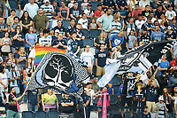 KANSAS CITY, KS - JULY 31: Sporting KC fans wave flags during a game between FC Dallas and Sporting Kansas City at Children's Mercy Park on July 31, 2021 in Kansas City, Kansas.