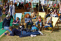 Pictured: A family rests on the festival green. Friday 31 May 2019<br /> Re: Hay Festival, Hay on Wye, Wales, UK.