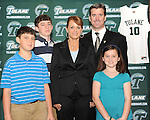Tulane hires Ed Conroy as their new men's basketball coach.  Coverage of the press conference announcement and a photoshoot with the new coach.