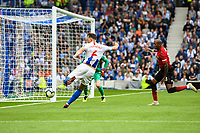 Dale Stephens of Brighton & Hove Albion (6)  Shoots at goal  during the Premier League match between Brighton and Hove Albion and Manchester United at the American Express Community Stadium, Brighton and Hove, England on 19 August 2018. Photo by Edward Thomas / PRiME Media Images.