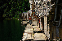 Bamboo huts on bamboo rafts on Cheow Lan Lake in Khao Sok National Park, Thailand, Southeast Asia. Theses bungalows are mostly used by tourists who want to spend one night on the lake. The Cheow Lan is a rock with fat clay core methodology used to construct the dam. This hydro electric dam on the Phra Saeng River was built in 1982 and the resulting reservoir lake covers an area of 185 square kilometers.