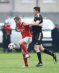 Daithi O Connell of Newmarket Celtic in action against Ryan Doherty of Janesboro during their Munster Junior Cup semi-final at Limerick. Photograph by John Kelly.
