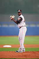 Arkansas Travelers starting pitcher Victor Alcantara (40) gets ready to deliver a pitch during a game against the Tulsa Drillers on April 25, 2016 at ONEOK Field in Tulsa, Oklahoma.  Tulsa defeated Arkansas 4-3.  (Mike Janes/Four Seam Images)
