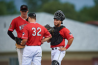 Batavia Muckdogs catcher Andres Sthormes (44), pitcher Brock Love (32), and first baseman Sean Reynolds (25) during a NY-Penn League game against the State College Spikes on July 3, 2019 at Dwyer Stadium in Batavia, New York.  State College defeated Batavia 6-4.  (Mike Janes/Four Seam Images)