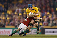MELBOURNE, 29 JUNE 2013 - James HORWILL, Captain of the Wallabies is tackled by Adam JONES of the Lions during the Second Test match between the Australian Wallabies and the British & Irish Lions at Etihad Stadium on 29 June 2013 in Melbourne, Australia. (Photo Sydney Low / sydlow.com)