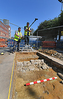 BNPS.co.uk (01202 558833)<br /> Pic: Zachary Culpin/BNPS<br /> <br /> Pictured: The team record their findings at the second dig site.<br /> <br /> An archaeological dig is underway at the site of a bloody Civil War battle in a bid to uncover artefacts hidden for 376 years.<br /> <br /> Four exploratory trenches have been dug as part of the excavation of the former medieval high street in Weymouth, Dorset.<br /> <br /> The seaside town witnessed the Battle of Weymouth in February 1645 where Parliamentarians outnumbered by six to one saw off a Royalist plot to seize it.<br /> <br /> Five hundred people were killed during the fighting and had the Royalists won, Charles I would have secured the safe south coast port he needed to land 35,000 French troops - potentially altering the course of history.