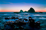 Landmark Three Arch Rocks seen near Arch Cape and Oceanside, Oregon.  Surf blurred milky by long exposure.