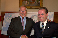 August 12,  2003, Montreal, Quebec, Canada<br /> <br /> Gerald Tremblay, Mayor of Montreal (L) shake hands with <br /> Claude Bechard, Quebec Minister of Work, Social Solidarity and Family (Emploi, SolidaritÈ Sociale et famille) (R)<br /> after an announcement about fighting poverty on the Montreal island, during a  press conference, august 12,  2003  in Montreal, CANADA<br /> <br /> <br /> Mandatory Credit: Photo by Pierre Roussel- Images Distribution. (©) Copyright 2003 by Pierre Roussel