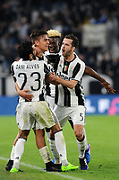 Calcio, Serie A: Juventus vs Milan. Torino, Juventus Stadium, 10 marzo 2017.<br /> Juventus' Paulo Dybala, second from left, celebrates with his teammates Dani Alves, left, Moise Kean, second from right and Miralem Pjanic, after scoring on a penalty kick the winning goal during the Italian Serie A football match between Juventus and AC Milan at Turin's Juventus Stadium, 10 March 2017. Juventus won 2-1.<br /> UPDATE IMAGES PRESS/Manuela Viganti
